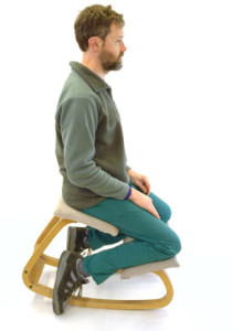 ergonomic sitting man